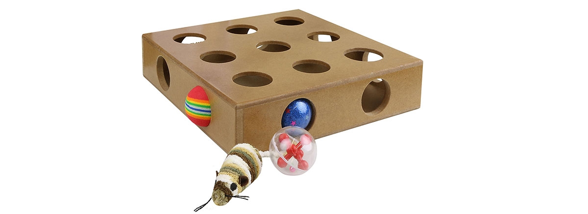 cat peek and play toy box with balls and mice in the holes
